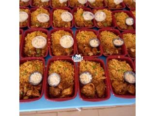 Delicious Jollof Rice with Chicken and Salad
