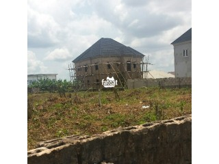 100ft by 200ft plot of Land